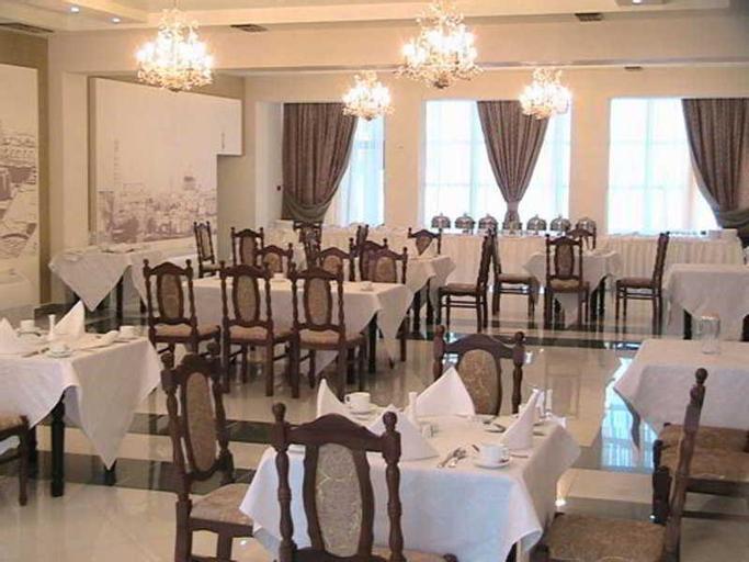 Silk Road Hotel, Konimex