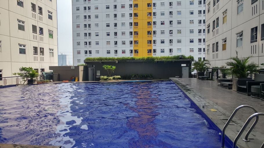 Clean And Tidy 2BR Green Pramuka Apartement By Travelio, East Jakarta