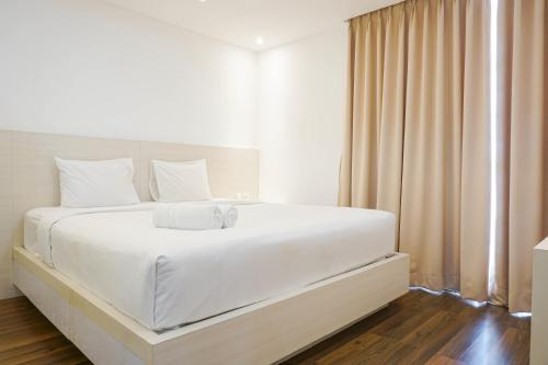 Cozy 1BR Royale Springhill Apartment with City View By Travelio, North Jakarta