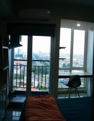 Cozy Studio Room at Tamansari Papilio Surabaya 26th Floor by FIR, Surabaya