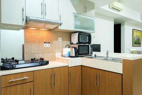 Cozy and Elegant 2BR Kemang Village Apartment By Travelio, South Jakarta