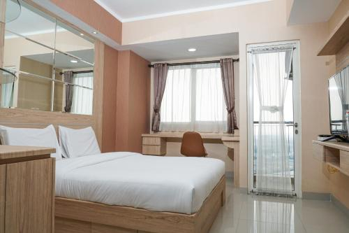 Best Homey Studio at The Oasis Apartment By Travelio, Cikarang