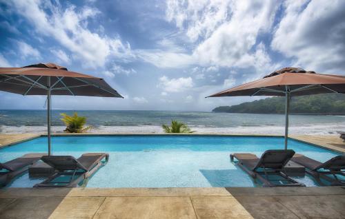 Pagua Bay House - Oceanfront Cabana's,