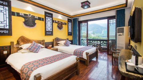 Floral Hotel · Huaxi Yihao Meisu Furong Town, Xiangxi Tujia and Miao