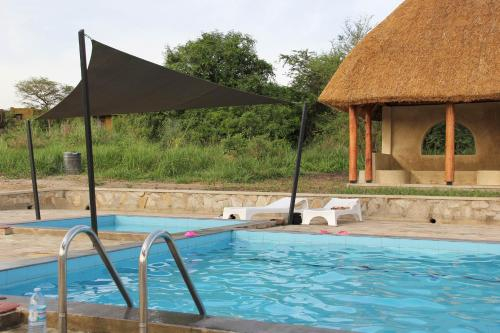 Relax by the amaizing pool enjoy the great amenities offered, Nwoya