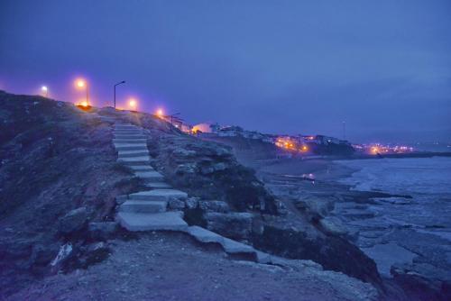 Lighthouse by the beach, Mafra
