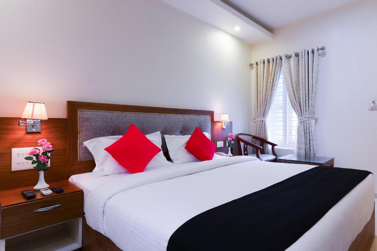 Capital O 65864 Hotel Soorya, Kollam