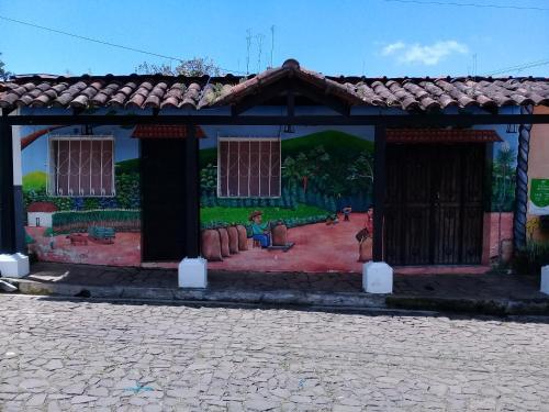 Portal de los Farolitos, Concepción de Ataco
