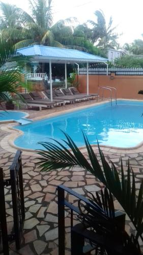 Studio in Pointe aux piments with shared pool balcony and WiFi 200 m from the beach,