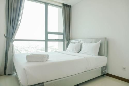 Homey with Private Lift 2BR Apartment at St. Moritz Puri near Mall By Travelio, Jakarta Barat