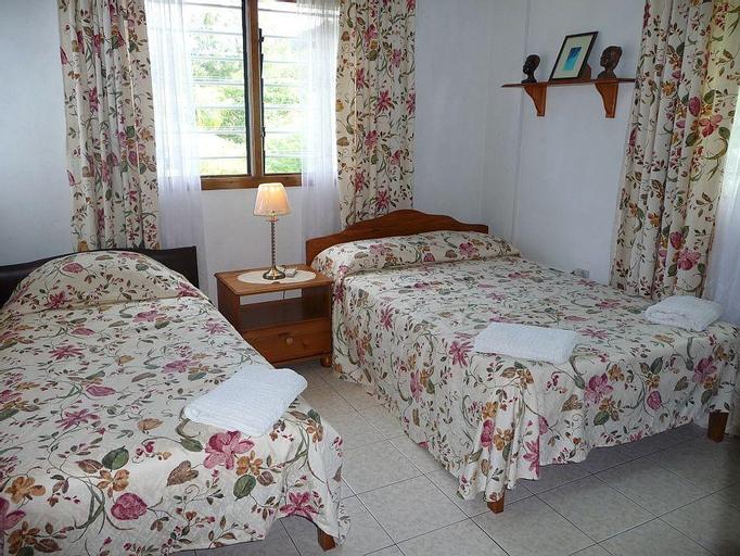 Le Manglier Guest House,