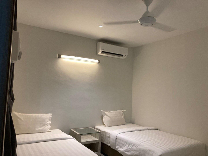 Two Single beds middle room at Taman Tas, Kuantan