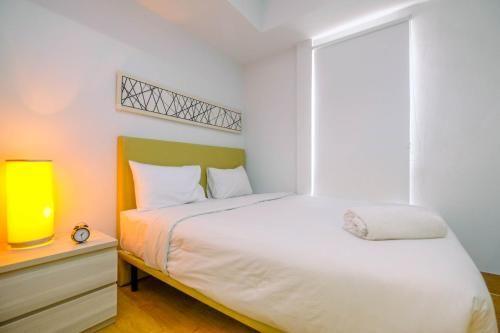 Modern Style Studio Apartment at Azalea Suites with City View By Travelio, Cikarang