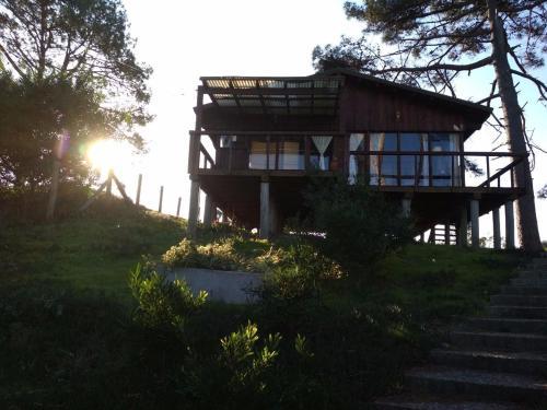 Cabana en la playa. ventanales y terraza al mar, n.a348