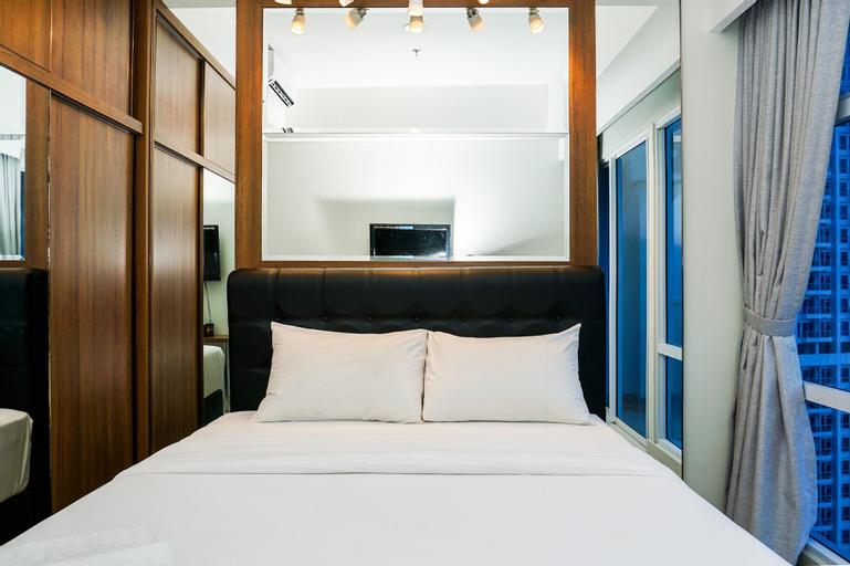 Minimalist Studio Room at Puri Mansion Apartment By Travelio, West Jakarta
