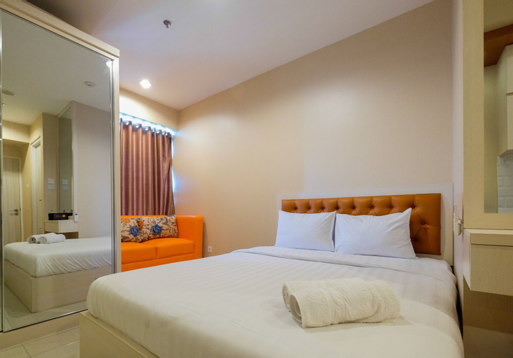 Relaxing and Homey Studio Grand Kamala Lagoon Apartment By Travelio, Bekasi