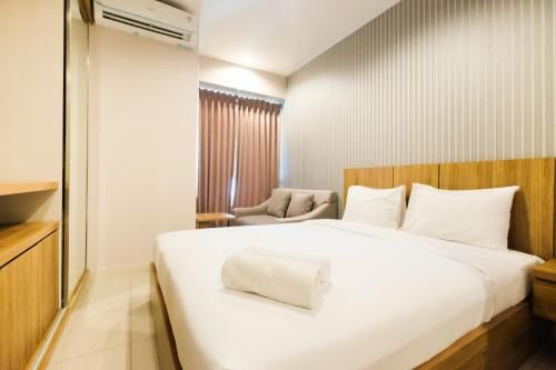 Best Furnished Studio at Grand Kamala Lagoon Apartment By Travelio, Bekasi