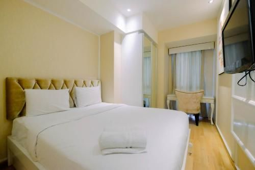 Stylish and Modern 1BR Casa Grande Apartment By Travelio, Jakarta Selatan