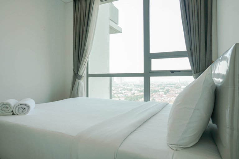 Homey with Private Lift 2BR Apartment at St. Moritz Puri near Mall By Travelio, West Jakarta