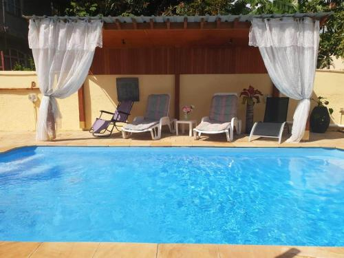 Villa with 3 bedrooms in Pointe aux Piments with wonderful mountain view private pool furnished terr,