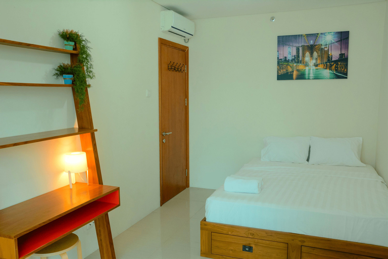 1BR Woodland Park Residence Kalibata View Swimming Pool By Travelio, South Jakarta