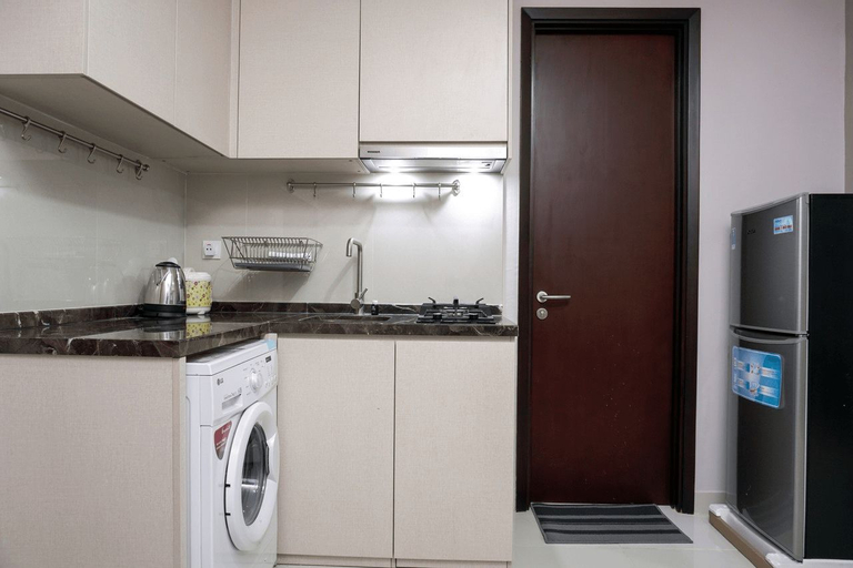 Good Location and High Floor 1BR at Puri Mansion Apartment By Travelio, West Jakarta