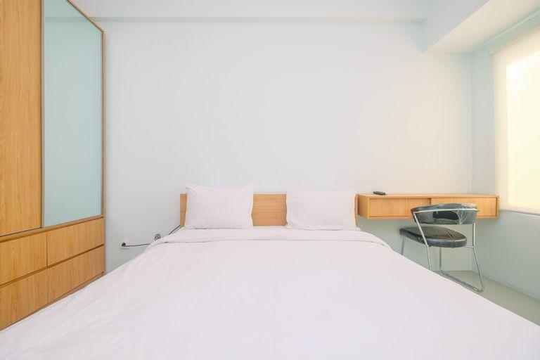 Modern Style Studio Tamansari Mahogany Apartment with City View By Travelio, Karawang
