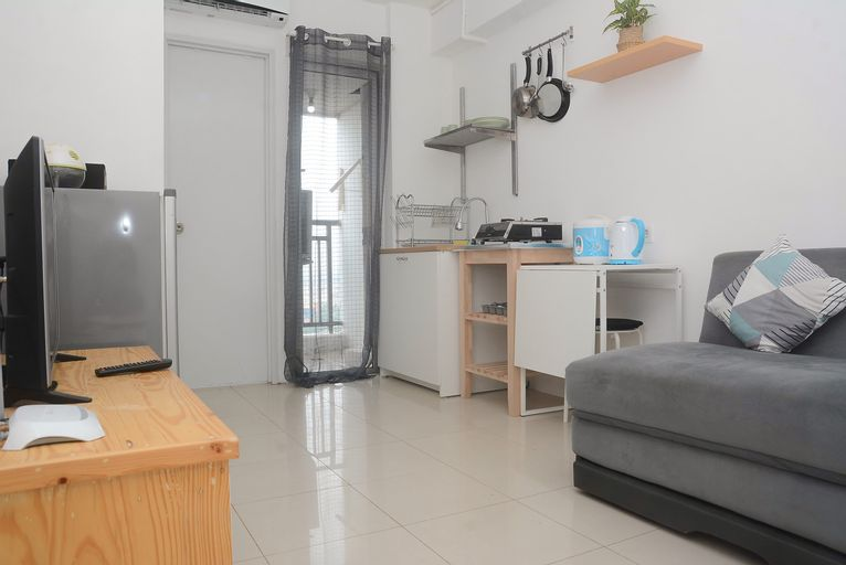 Fully Furnished and Cozy Design 2BR Bassura City Apartment By Travelio, East Jakarta
