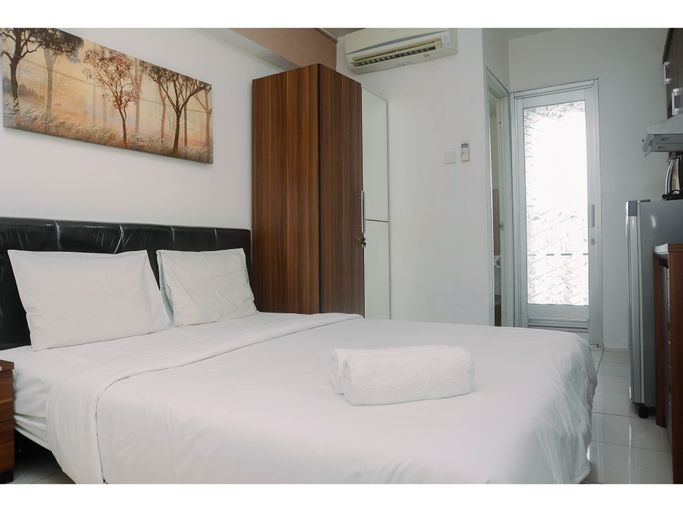 Good and Comfy Studio Room at Green Bay Pluit Apartment By Travelio, North Jakarta