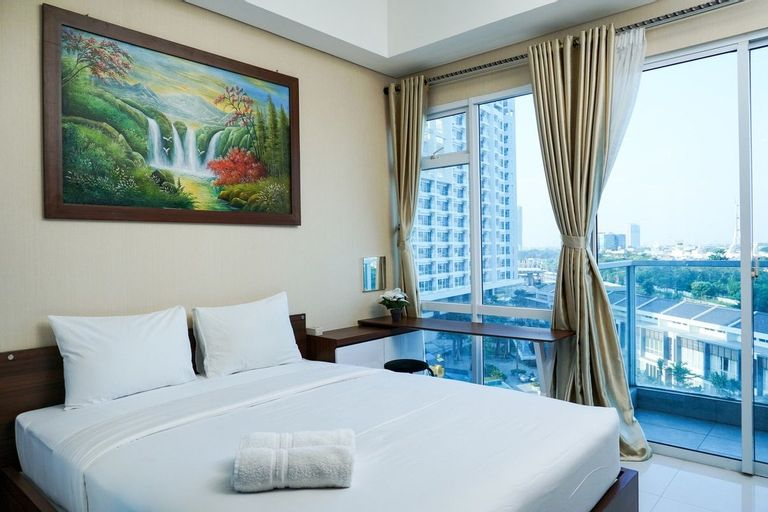Deluxe and Comfortable Studio Puri Mansion Apartment By Travelio, West Jakarta