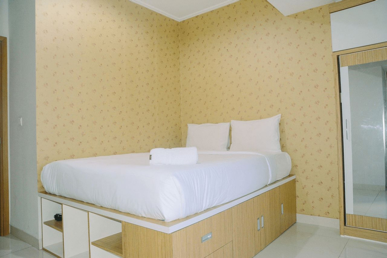 Modern and Comfy 2BR with Golf View at The Mansion Kemayoran By Travelio, North Jakarta