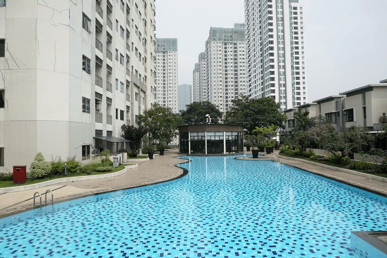 Spacious and Fully Furnished 2BR Cosmo Mansion Apartment By Travelio, Central Jakarta