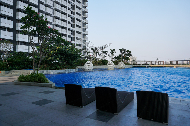 Relax and Comfy with Pool View @ Studio West Vista Apartment By Travelio, West Jakarta