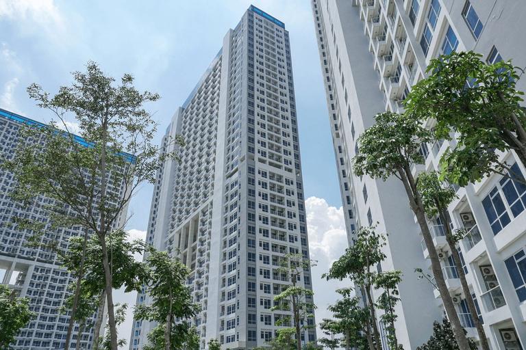 Modern Studio Room Puri Mansion Apartment By Travelio, West Jakarta