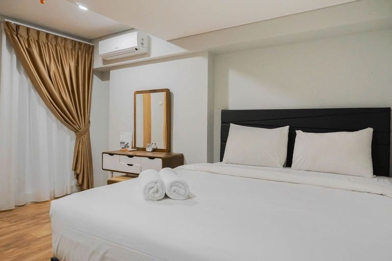 Modern 2BR Apartment at Maqna Residence By Travelio, West Jakarta