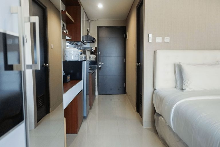 Modern Studio Apartment at Tamansari Papilio By Travelio, Surabaya
