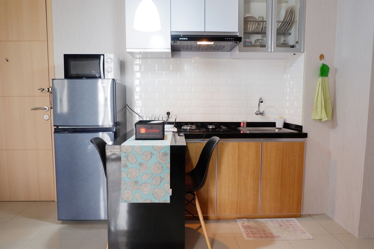 Comfort 1BR Apartment with Sofa Bed connected to Mall Bassura City By Travelio, East Jakarta