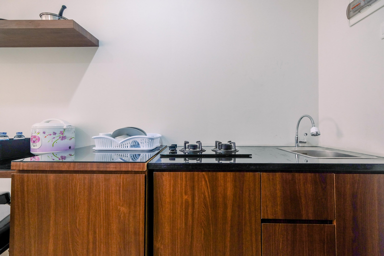 Elegant with Modern Design 1BR Apartment at Atlanta Residences By Travelio, Depok