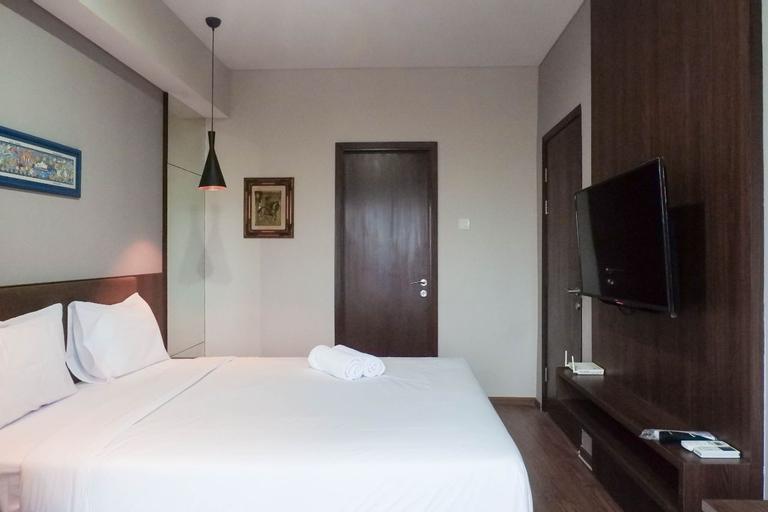 Classy 1BR Apartment with Pool View at Grand Sungkono Lagoon By Travelio, Surabaya