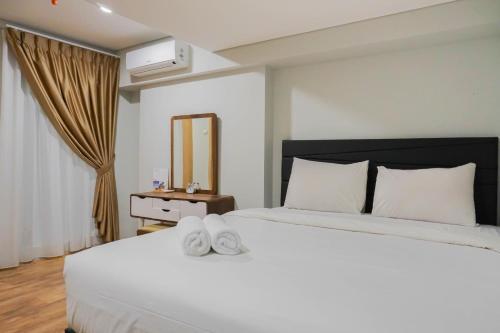 Modern 2BR Apartment at Maqna Residence By Travelio, Jakarta Barat