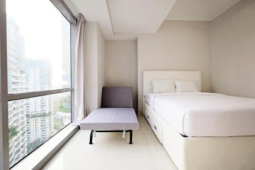 2BR Modern Living at The Mansion Apartment near Kemayoran By Travelio, North Jakarta