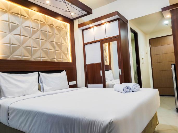 Homey and Comfy Studio at Vida View Makasar Apartment By Travelio, Makassar
