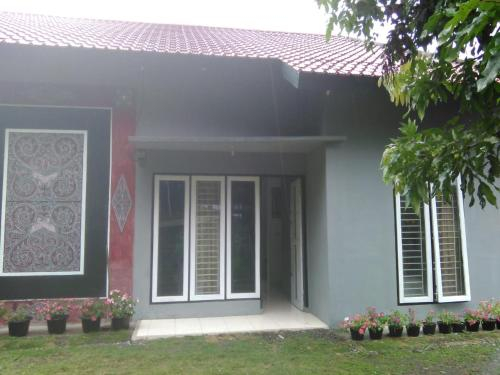 Villa Sahala Simanjuntak, Toba