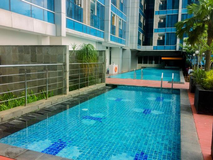 Cozy Living 1BR Tamansari The Hive Apt By Travelio, East Jakarta